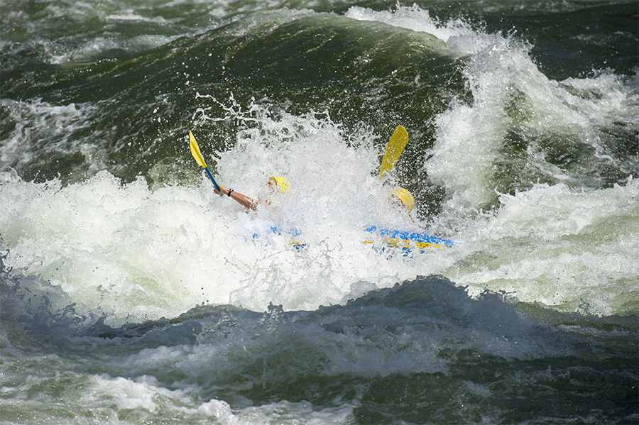 Philip Edwards ,left, and his father scoutmaster Dale Edwards of Boy Scout Troop 227, from St. Croix , U.S. Virgin Islands get swallowed up by the Five Mile rapid on the morning of the third day  during the their whitewater rafting trip down the Salmon River in northern Idaho.