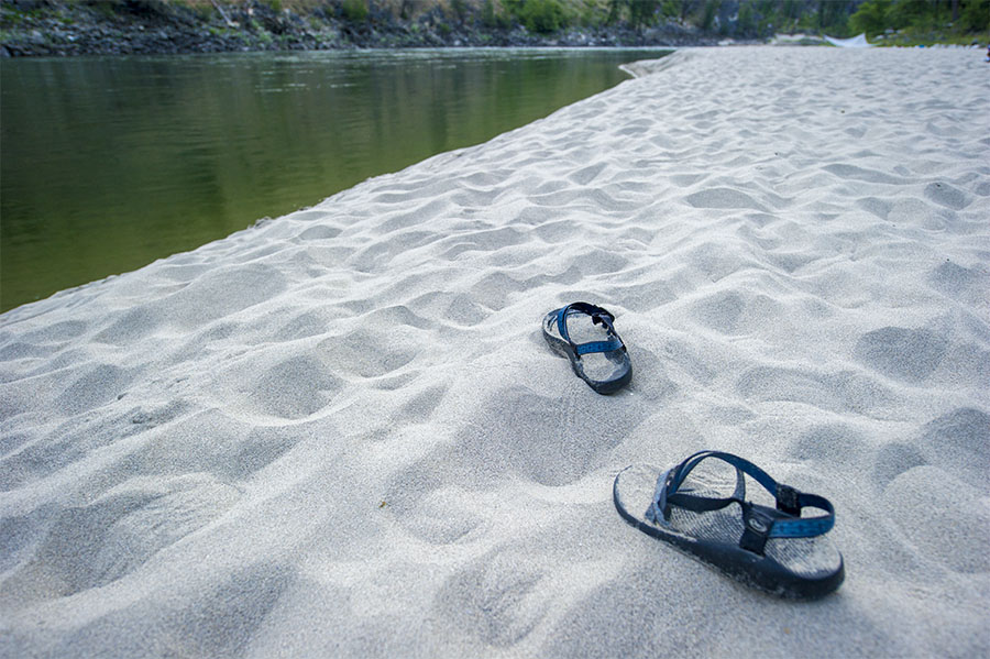 On the morning of Day Five a pair of scout's river sandals sits idle in the sand on the Maxwell river bar  on Day Five of their Salmon River whitewater rafting trip in northern Idaho.